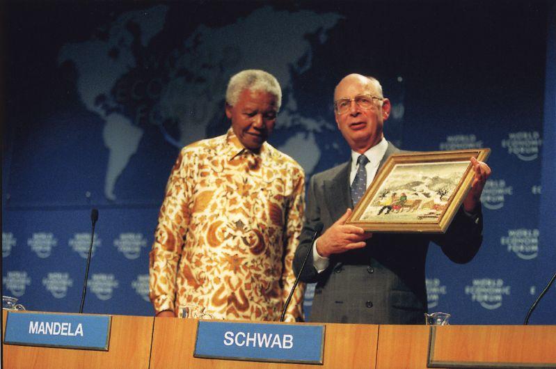photo of Nelson Mandela and Klaus Schwab