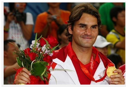 Roger with Olympic gold medal